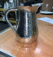 Hammered silver water pitcher